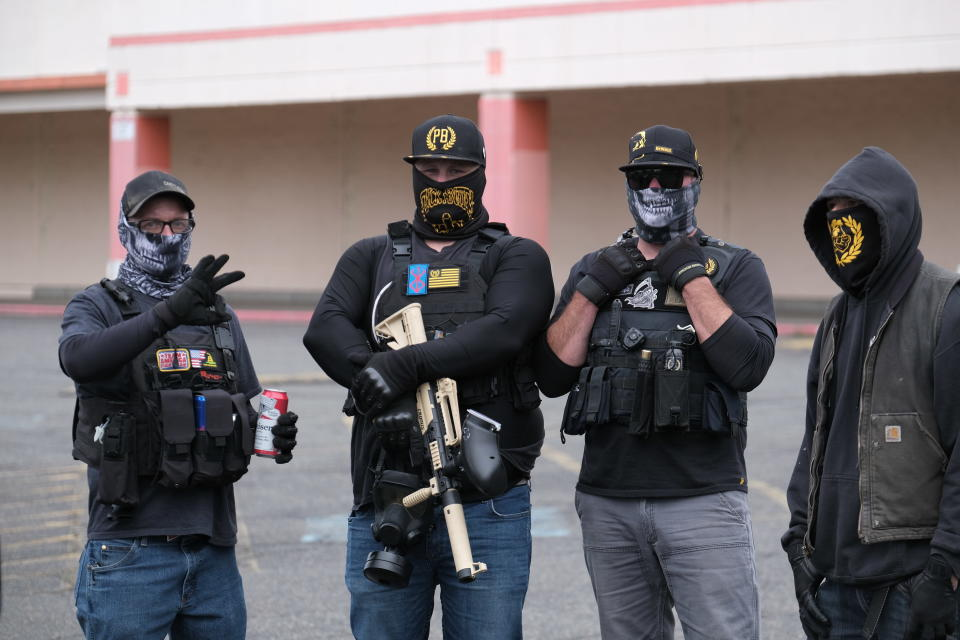 Members of the far-right group Proud Boys gather for a rally in an abandoned parking lot on the outskirts of town on Sunday, Aug. 22, 2021, in Portland, Ore. (AP Photo/Alex Milan Tracy)