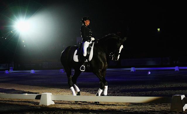 Katie Price and her horse 'Jordans Glamour Girl' perform Dressage to Music during the Horse of the Year Show in 2008 (Credit: Getty Images)