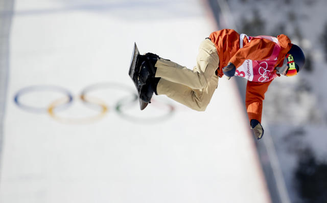 <p>Seppe Smits, of Belgium, jumps during the men's Big Air snowboard qualification competition at the 2018 Winter Olympics in Pyeongchang, South Korea, Wednesday, Feb. 21, 2018. (AP Photo/Dmitri Lovetsky) </p>