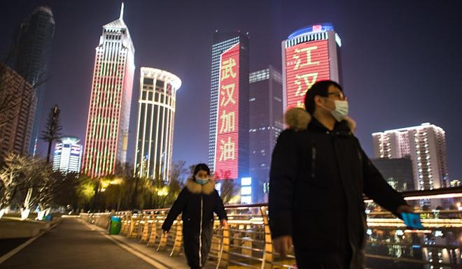 Illuminated buildings in Wuhan try to bring some cheer to the city's residents. Photo: Xinhua