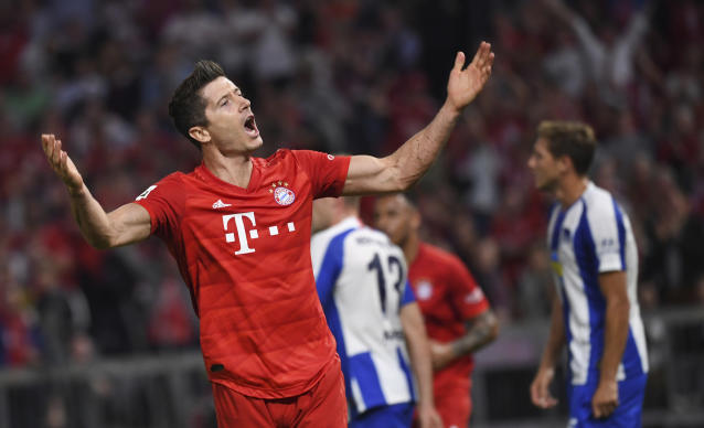 Bayern Munich's Robert Lewandowski celebrates after scoring the opening goal during the German Bundesliga soccer match between Bayern Munich and Hertha BSC Berlin in Munich on Friday, Aug. 16, 2019. (Matthias Balk/dpa via AP)
