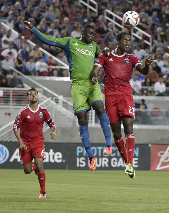 San Jose Earthquakes midfielderAtiba Harris, right, goes up for a header next to Seattle Sounders' Jalil Anibaba, center, during the first half of an MLS soccer match Saturday, Aug. 2, 2014, in Santa Clara, Calif. (AP Photo/Marcio Jose Sanchez