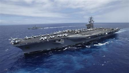 The USS Nimitz, a nuclear-powered aircraft carrier which is currently supplemented by biofuel, sails about 150 miles north of the island of Oahu during the RIMPAC Naval exercises off Hawaii July 18,2012. REUTERS/Hugh Gentry