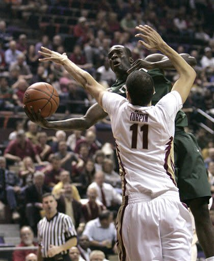 Miami's Durand Scott looks for a shot against Florida State's Kiel Turpin during the first half of an NCAA college basketball game Wednesday, Feb. 13, 2013, in Tallahassee, Fla. (AP Photo/Steve Cannon)