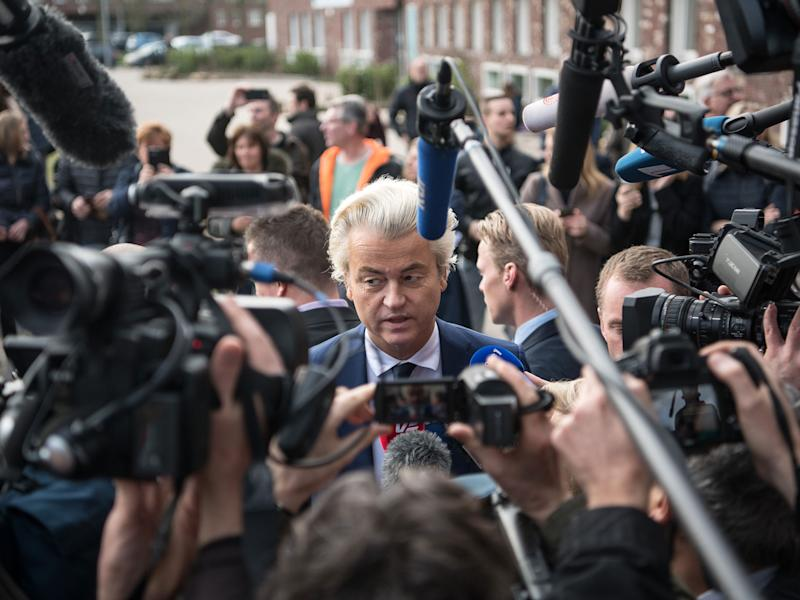 Geert Wilders speaks to the media after casting his vote during the Dutch general election, on 15 March, 2017 in The Hague: Getty Images