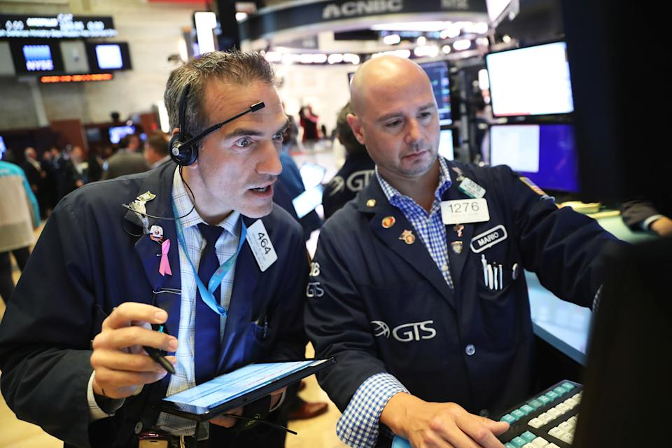 Traders work on the floor of the New York Stock Exchange shortly after the opening bell in New York, U.S., July 12, 2019. REUTERS/Lucas Jackson