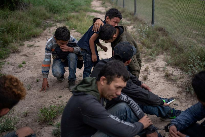 Migrants apprehended by Border Patrol agents