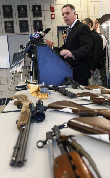 "In this Feb. 26, 2013 file photo, Chicago Police Superintendent Garry McCarthy stands near guns confiscated in Chicago and talks about the department's efforts to curb gun violence during a news conference in Chicago. As Illinois Gov. Pat Quinn mulls whether to sign off on eliminating the nation's last ban on public possession of guns, the question in Chicago is whether it will matter in the crime-weary city where a spiking murder rate drew national attention last year. McCarthy calls a requirement that people go through only 16 hours of training before they are issued a concealed carry permit ""Incredibly troubling."" (AP Photo/Charles Rex Arbogast, File)"