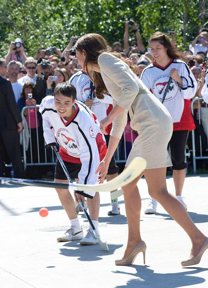 <p>Kate played street hockey (in some very sports-inappropriate shoes), while visiting Yellowknife, Canada. </p>