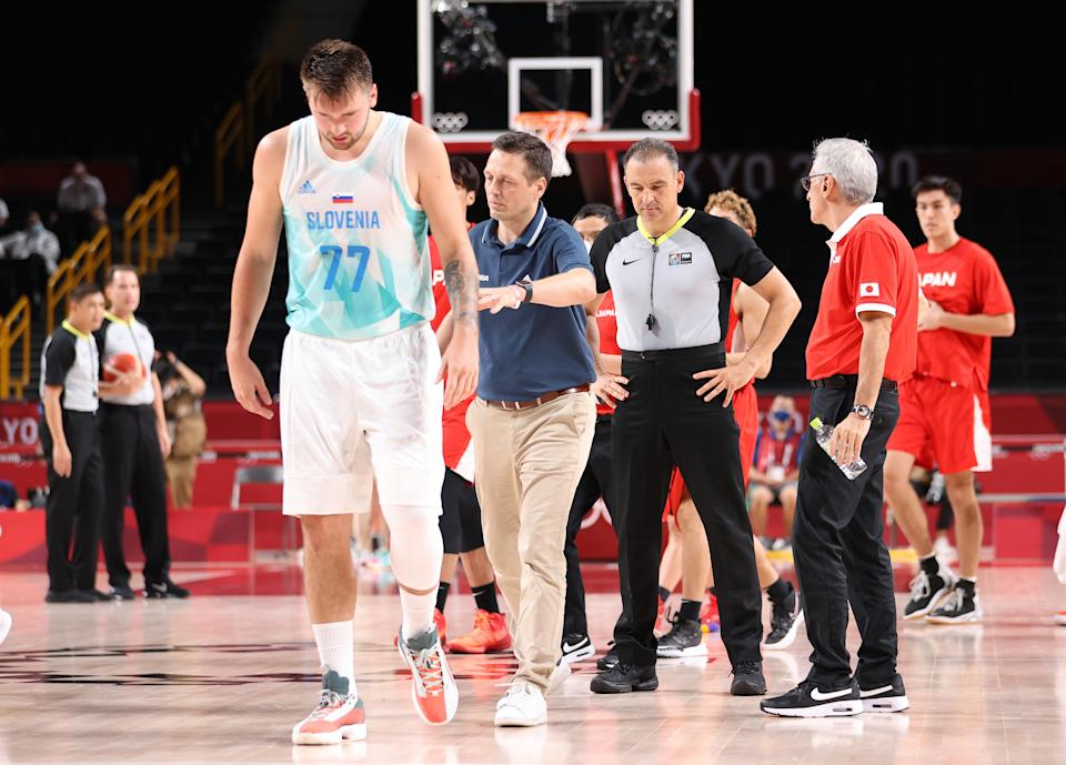 SAITAMA, JAPAN - JULY 29: Head coach Aleksander Sekulic of Team Slovenia pushes Luka Doncic #77 away from the referee at half time in a Men's Preliminary Round Group C game against Japan on day six of the Tokyo 2020 Olympic Games at Saitama Super Arena on July 29, 2021 in Saitama, Japan. (Photo by Gregory Shamus/Getty Images)