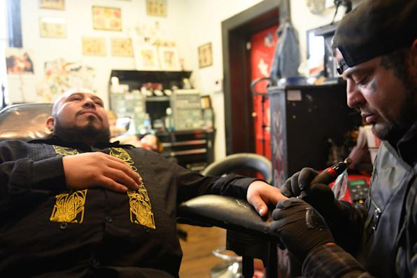 After losing part of two fingers in a work accident 16 years ago, José Alvarado receives two fingernail tattoos at Eternal Ink Tattoo Studio on Nov. 20, 2019, in Hecker, Ill. (Michael B. Thomas for KHN)
