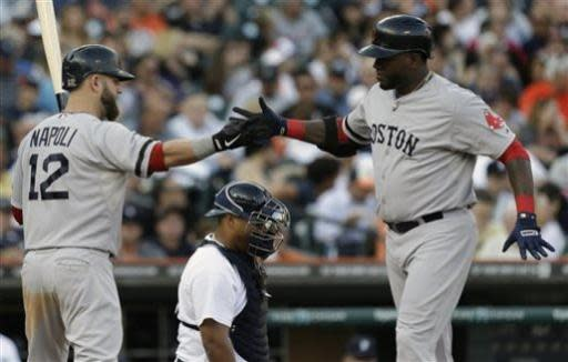 Boston Red Sox's David Ortiz, right, is congratulated by teammate Mike Napoli (12) after hitting a solo home run against the Detroit Tigers in the fourth inning of a baseball game in Detroit, Thursday, June 20, 2013. (AP Photo/Paul Sancya)
