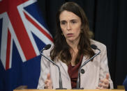 New Zealand Prime Minister Jacinda Ardern speaks during a post-Cabinet press conference on the 1970's dawn raids at Parliament in Wellington, New Zealand, Monday, June 14, 2021. New Zealand's government is formally apologizing for an immigration crackdown nearly 50 years ago in which Pacific people were targeted for deportation, often after early-morning home raids. (Mark Mitchell/NZ Herald via AP)