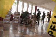 Soldiers handle electoral material at a polling station ahead of Ecuador's presidential election on February 7, in Quito