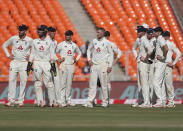 England's captain Joe Root, center, and teammates await third umpire's decision for the wicket of India's Rishabh Pant during the second day of fourth cricket test match between India and England at Narendra Modi Stadium in Ahmedabad, India, Friday, March 5, 2021. (AP Photo/Aijaz Rahi)