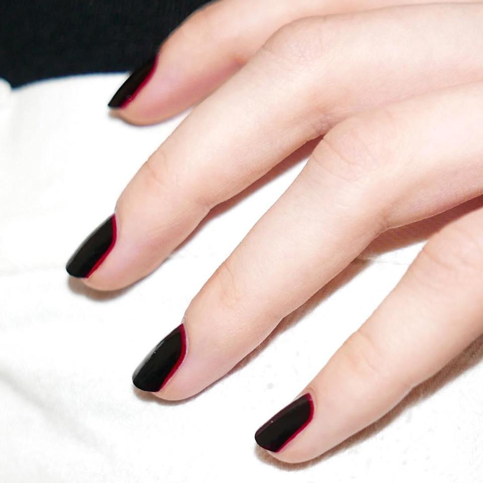 """Start with a bright red base and layer a dark burgundy shade on top so just a sliver of red peeks out at the cuticle. (Need recs? <a href=""""https://www.glamour.com/gallery/best-dark-red-nail-polishes?mbid=synd_yahoo_rss"""" rel=""""nofollow noopener"""" target=""""_blank"""" data-ylk=""""slk:We've got tons"""" class=""""link rapid-noclick-resp"""">We've got tons</a>.)"""