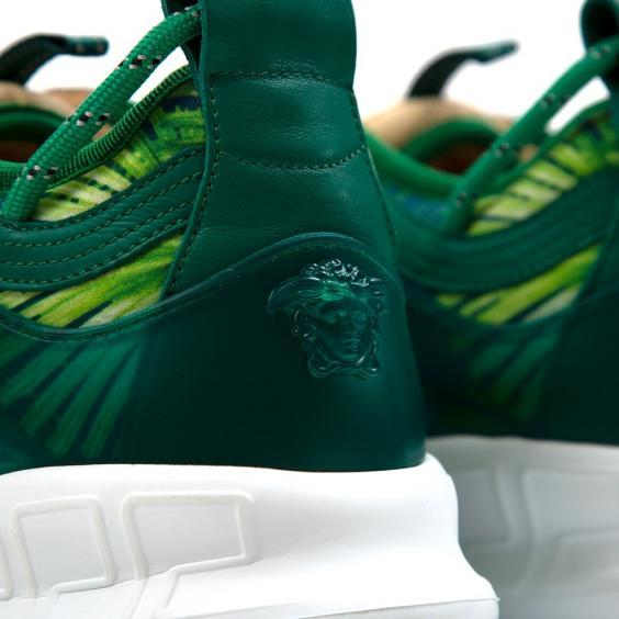 A close-up of the Versace logo on the back of the trainer (Concepts)