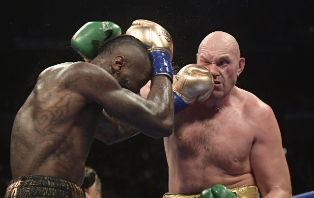 Deontay Wilder, left, connects with Tyson Fury, of England, during a WBC heavyweight championship boxing match, Saturday, Dec. 1, 2018, in Los Angeles. (AP Photo/Mark J. Terrill)