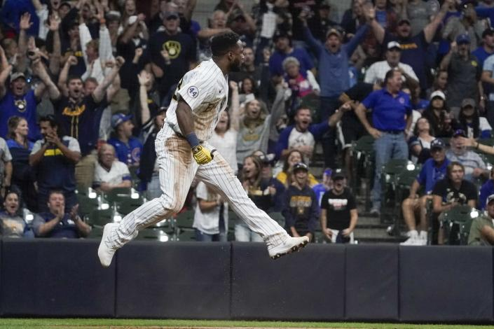 Milwaukee Brewers' Pablo Reyes scores reacts after scoring during the eighth inning of a baseball game against the Chicago Cubs Saturday, Sept. 18, 2021, in Milwaukee. Reyes scored on a hit by Kolten Wong. (AP Photo/Morry Gash)