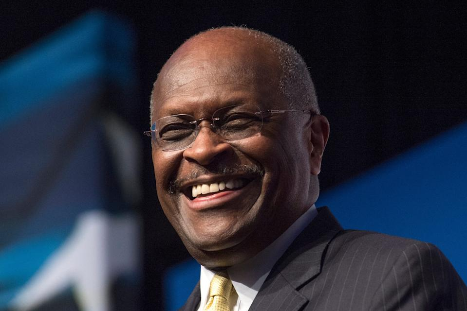 Herman Cain, CEO, The New Voice, speaks during Faith and Freedom Coalition's Road to Majority event in Washington on June 20, 2014. Former Republican presidential candidate Herman Cain died after a battle with COVID-19, according to posts on his Twitter account and on his website.