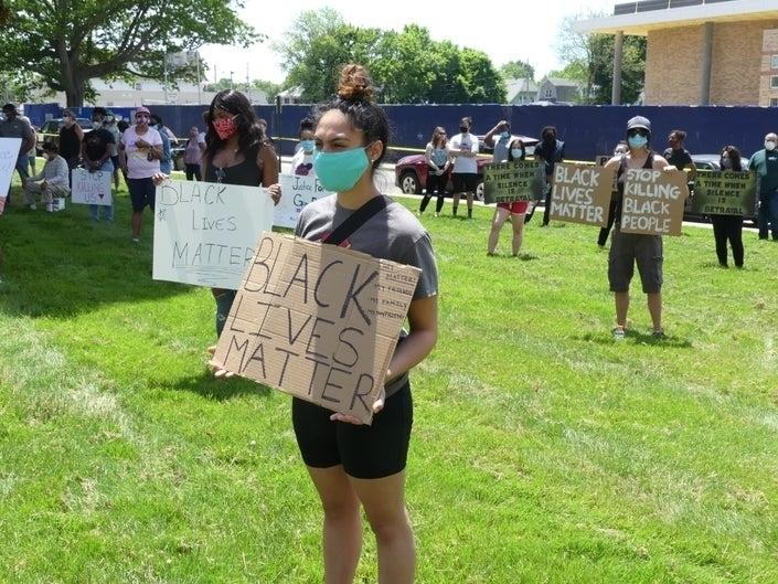"""A protester holds a """"Black Lives Matter"""" sign at a demonstration May 30 in Stratford."""