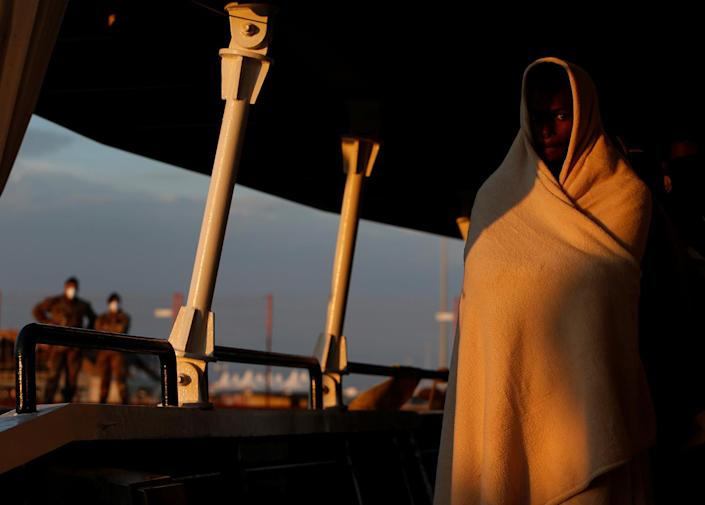 <p>A rescued migrant waits to disembark from the Malta-based NGO Migrant Offshore Aid Station (MOAS) ship Phoenix in Pozzallo on the island of Sicily, Italy, April 6, 2017. (Photo: Darrin Zammit Lupi/Reuters) </p>