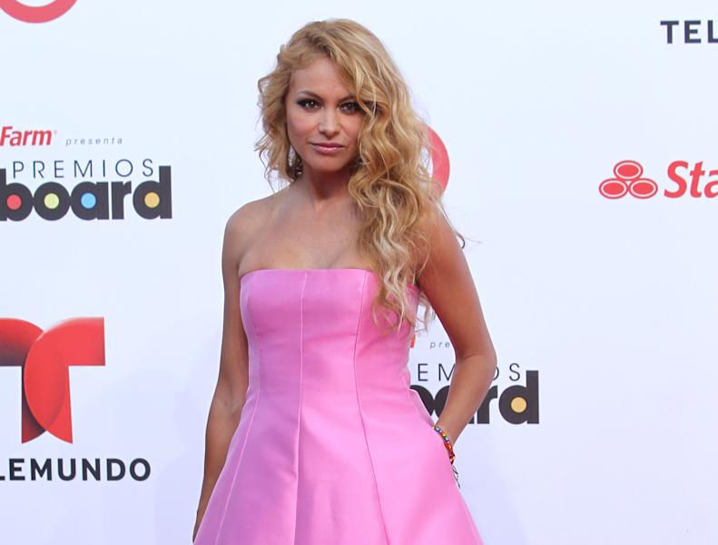 "FILE - This April 25, 2013 file photo shows Mexican singer Paulina Rubio at the Latin Billboard Awards in Coral Gables, Fla. Simon Cowell has added former Destiny's Child singer Kelly Rowland and Latin artist Paulina Rubio to the cast of his competition show ""The X Factor."" Rowland and Rubio will be on the show when it starts its third season on Fox this fall. They replace Britney Spears and record producer Antonio ""L.A."" Reid. (Photo by Carlo Allegri/Invision/AP, file)"