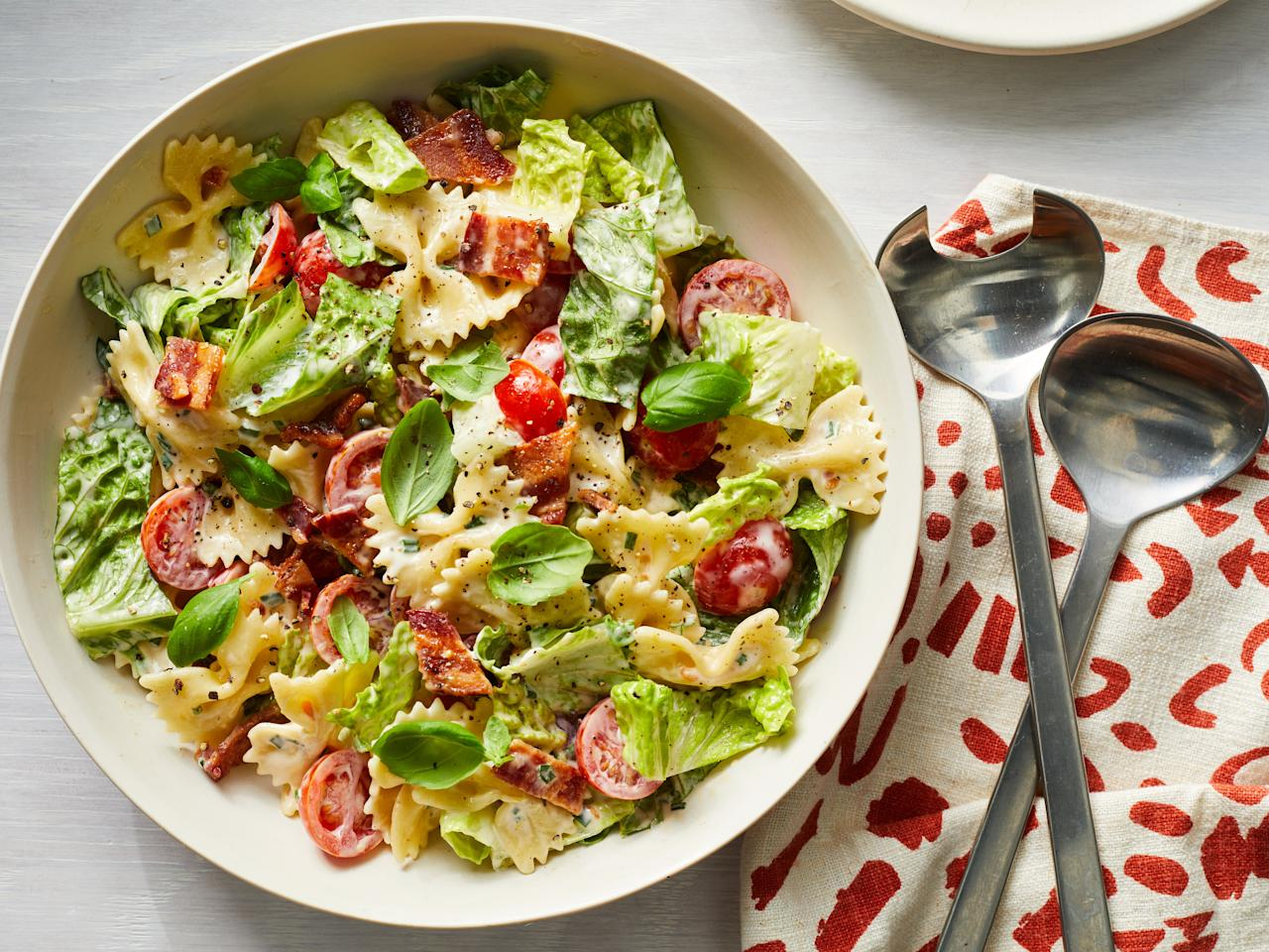 """<p>If you're looking for a foolproof side to take to your next barbecue or potluck, you've come to the right place. This BLT Pasta Salad is essentially a BLT in a bowl, and who could turn that down? It's creamy and crunchy, just like the sandwich, and packs a delicious punch, especially with the use of fresh tomatoes and lettuce. If you have access to heirloom cherry tomatoes, feel free to use those instead. You could also use baby arugula instead of lettuce for a peppery zing. You can prepare this ahead of time, but don't dress until immediately before serving—otherwise, the lettuce will wilt and lose its crisp.</p> <p><a href=""""https://www.myrecipes.com/recipe/blt-pasta-salad-2"""">BLT Pasta Salad Recipe</a></p>"""
