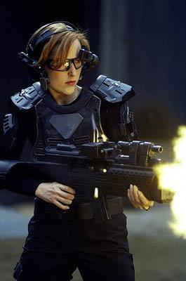"While investigating the murder of a teen killed while playing a virtual reality game, Agent Scully (Gillian Anderson) enters the high-tech virtual game to track down their suspect in the ""First Person Shooter"" episode of  Fox's The X-Files X-Files"