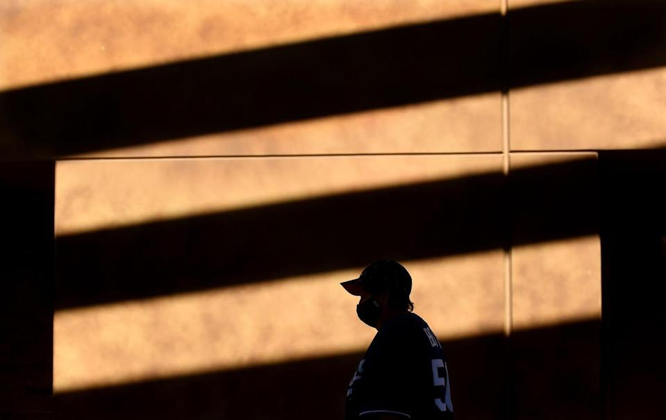 A Dodgers fan walks to a concession stand before a game