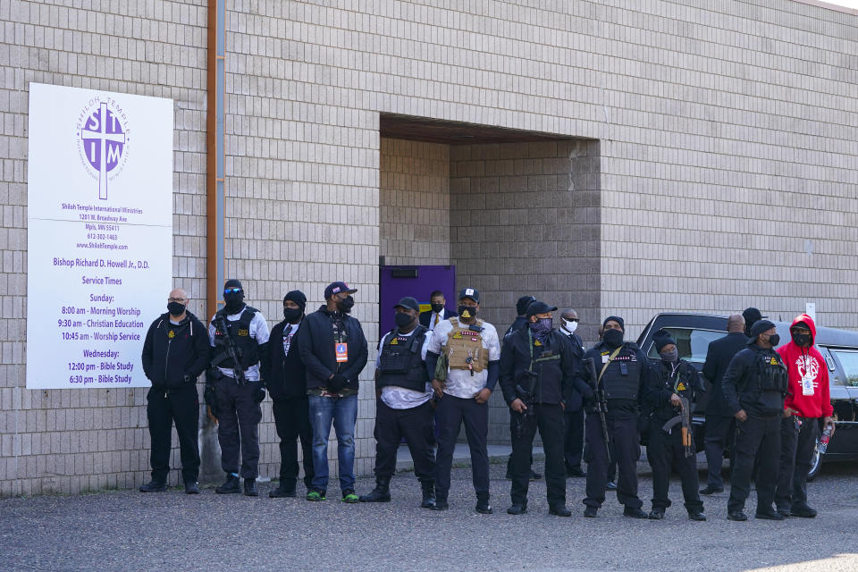 Members of Minnesota Freedom Fighters gather around the hears carrying Daunte Wright's casket at Shiloh Temple International Ministries in Minneapolis, Thursday, April 22, 2021. The 20-year-old Wright was killed by then-Brooklyn Center police officer Kim Potter during a traffic stop on April 11. (AP Photo/Julio Cortez)