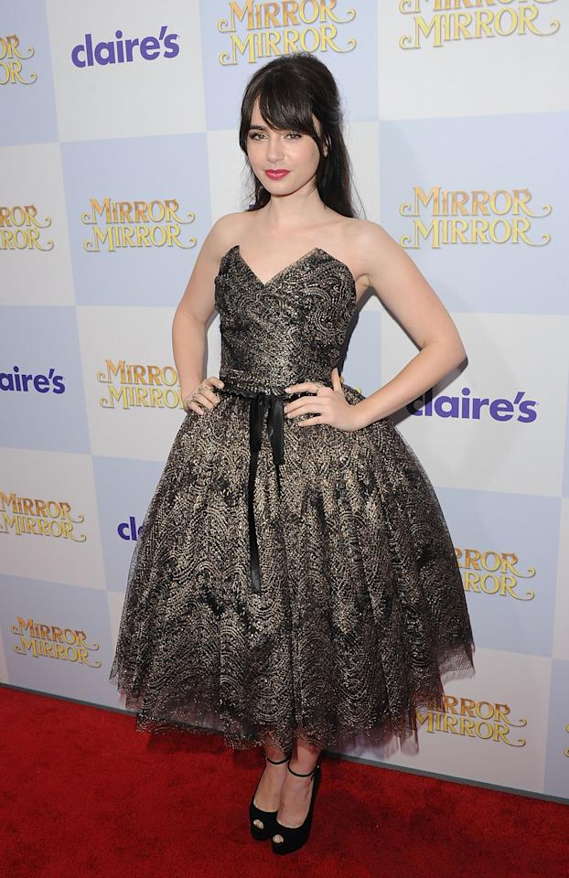 HOLLYWOOD, CA - MARCH 17:  Actress Lily Collins attends the 'Mirror Mirror' premiere at Grauman's Chinese Theatre on March 17, 2012 in Hollywood, California.  (Photo by Jason Merritt/Getty Images)