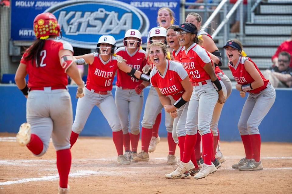 The Butler Bearettes celebrated at home plate after Kyndal Tinnell (12) hit a grand slam against Daviess County during the KHSAA State Softball Championship at John Cropp Stadium.