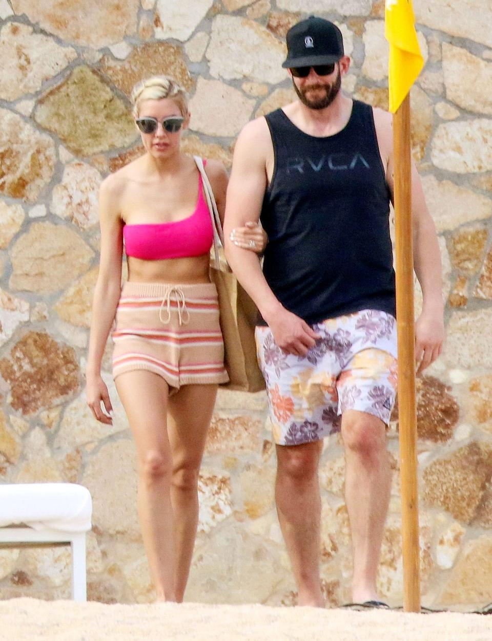 <p>Tarek El Moussa and Heather Rae Young soak up some sun in Cabo San Lucas, Mexico on Sunday.</p>