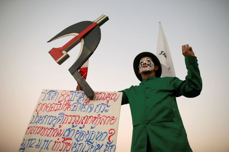 FILE PHOTO: A demonstrator gestures during a pro-democracy rally demanding reforms on the monarchy and for the government to resign, in Bangkok