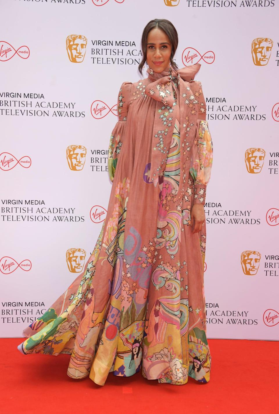<p>Zawe Ashton wore a dusty-pink Zimmermann gown with multicolour illustrations.</p>