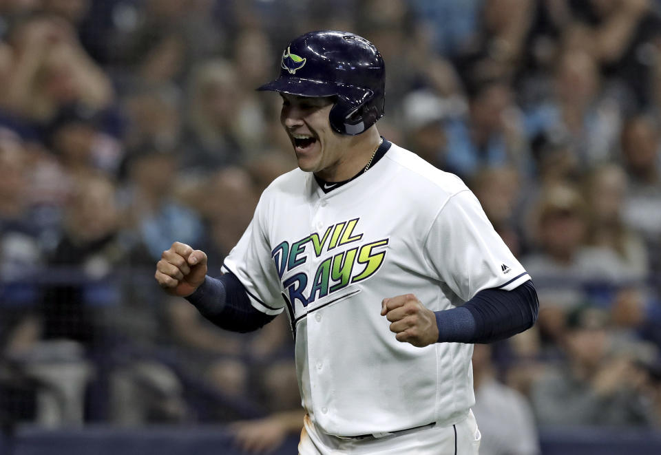 Tampa Bay Rays' Avisail Garcia celebrates after scoring on a single by Willy Adames off New York Yankees relief pitcher Jonathan Holder during the sixth inning of a baseball game Saturday, May 11, 2019, in St. Petersburg, Fla. (AP Photo/Chris O'Meara)