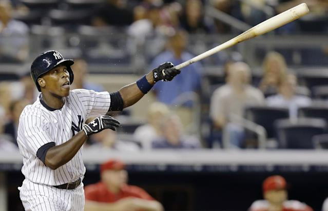 New York Yankees' Alfonso Soriano watches his seventh-inning, three-run home run off Los Angeles Angels starting pitcher Joe Blanton in a baseball game, Tuesday, Aug. 13, 2013, in New York. (AP Photo/Kathy Willens)