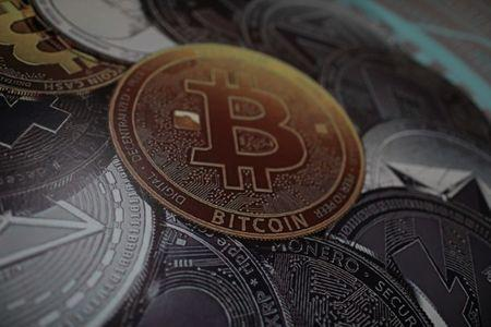 FILE PHOTO: A bitcoin logo is seen at a facility of the Youth and Sports Ministry in Caracas