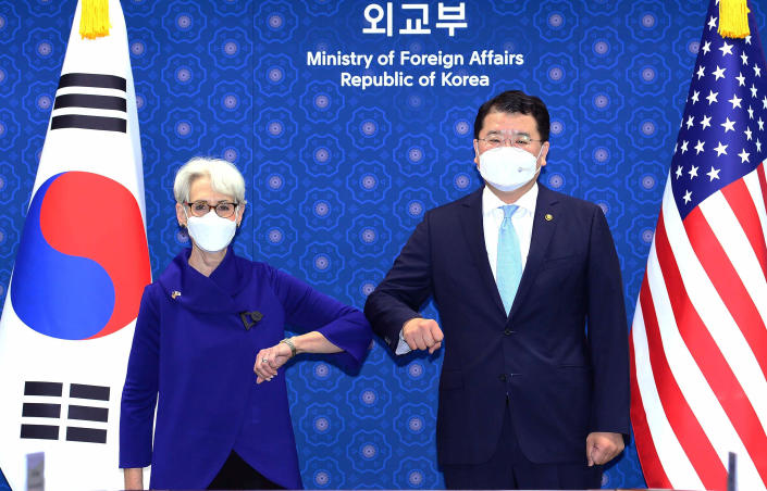 In this photo provided by South Korea Foreign Ministry, U.S. Deputy Secretary of State Wendy Sherman, left, bumps elbows with South Korean First Vice Foreign Minister Choi Jong Kun prior to their meeting at the Foreign Ministry in Seoul, South Korea, Friday, July 23, 2021. Top U.S. and South Korean officials agreed Thursday to try to convince North Korea to return to talks on its nuclear program, which Pyongyang has insisted it won't do in protest of what it calls U.S. hostility. (South Korea Foreign Ministry via AP)