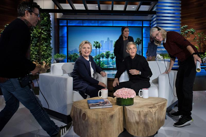 "Hillary Clinton and Ellen DeGeneres during a commercial break on a 2016 episode of ""The Ellen DeGeneres Show."" (BRENDAN SMIALOWSKI via Getty Images)"