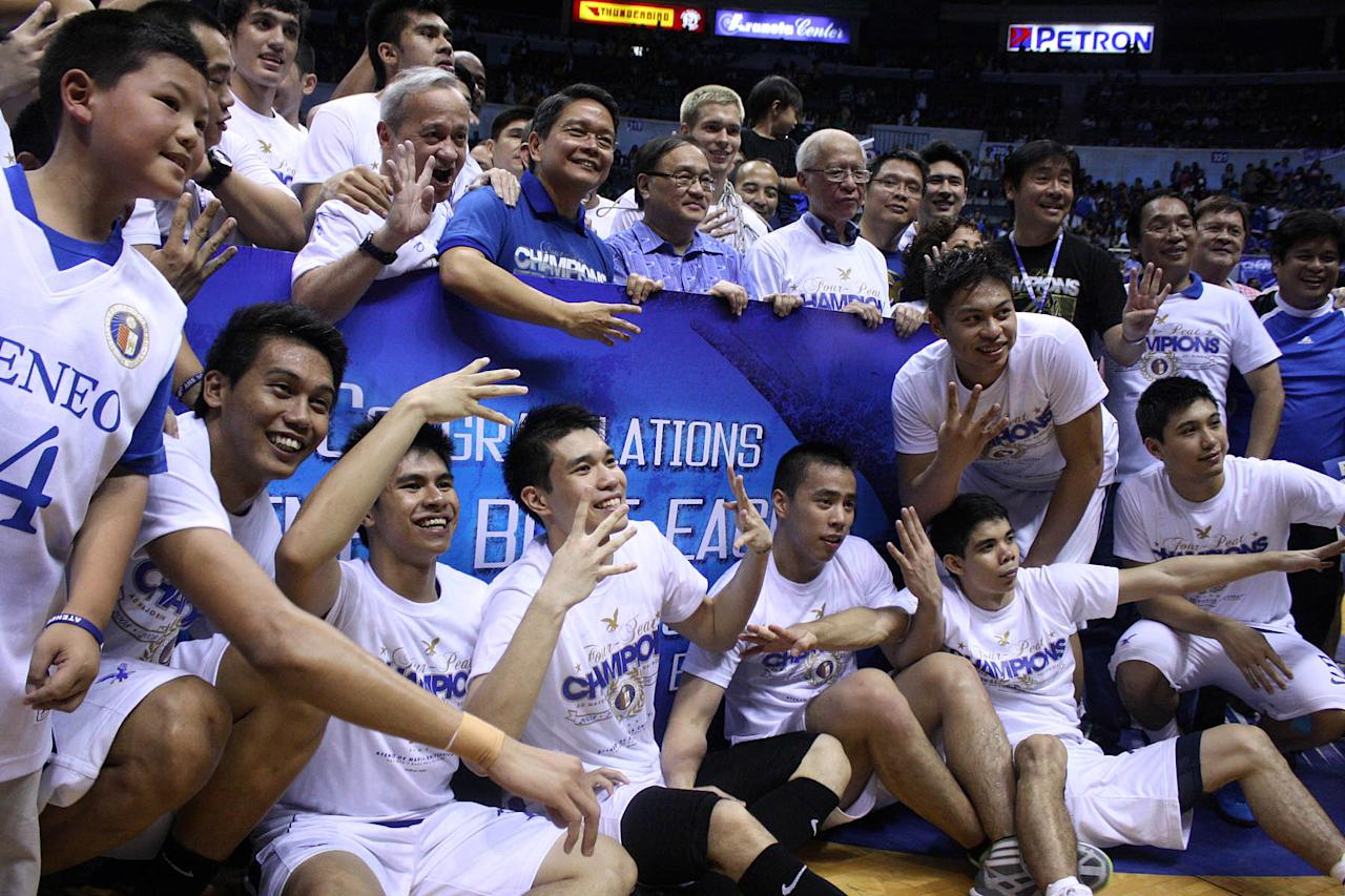 Ateneo Blue Eagles together with Smart Communications Inc. chairman Manny Pangilinan pose for a photo opportunity after the game 2 of the 74th Season of the UAAP basketball championship series held at Smart Araneta Coliseum in Quezon City. Ateneo won its fourth straight UAAP championship against FEU Tamaraws with a score of 82-69. (Marlo Cueto/NPPA Images)