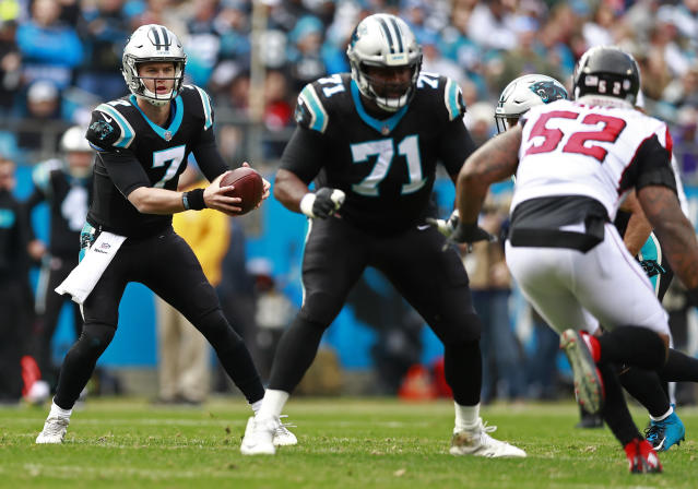 Carolina Panthers Kyle Allen (7) looks to pass against the Atlanta Falcons during the first half of an NFL football game in Charlotte, N.C., Sunday, Dec. 23, 2018. (AP Photo/Jason E. Miczek)
