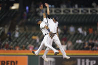 Detroit Tigers' Willi Castro, left, and Harold Castro, right, celebrate after the final out in the ninth inning of a baseball game against the Chicago White Sox in Detroit, Monday, Sept. 20, 2021. Detroit won 4-3. (AP Photo/Paul Sancya)