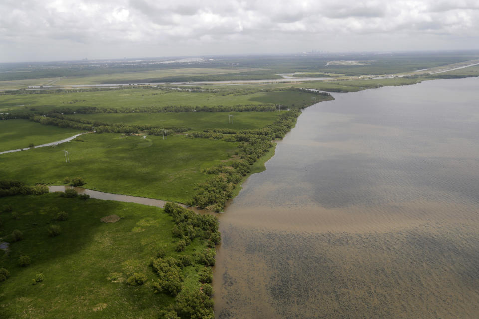 FILE - This May 1, 2019, file photo shows the Davis Pond Diversion emptying into Lake Cataouache, with tree growth on the edges of the channels in St. Charles Parish, La. A nearly $2 billion plan to divert water and sediment from the Mississippi River to rebuild land in southeastern Louisiana, a proposal considered the cornerstone of the state's efforts to protect its rapidly eroding coast, has passed a major milestone with the publication of the Army Corps of Engineers long-awaited environmental impact study, Thursday, March 4, 2021. (AP Photo/Gerald Herbert, File)