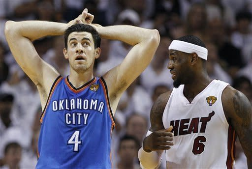 Oklahoma City Thunder power forward Nick Collison (4) and Miami Heat small forward LeBron James (6) react during the second half at Game 3 of the NBA Finals basketball series, Sunday, June 17, 2012, in Miami. The Heat won 91-85. (AP Photo/Lynne Sladky)