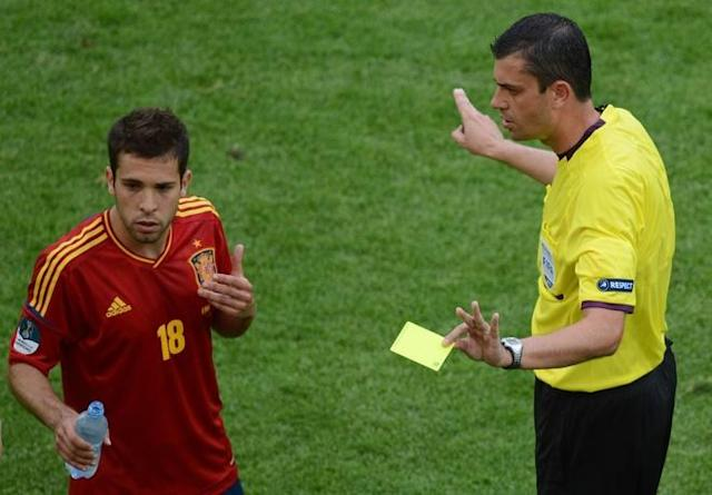 Spanish defender Jordi Alba (L) is shown a yellow card by referee during the Euro 2012 championships football match Spain vs Italy on June 10, 2012 at the Gdansk Arena. AFPPHOTO/ PATRIK STOLLARZPATRIK STOLLARZ/AFP/GettyImages