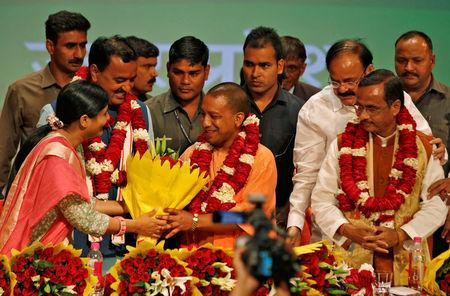 India's ruling Bharatiya Janata Party (BJP) leader Yogi Adityanath (C) is greeted after he was elected as Chief Minister of India's most populous state of Uttar Pradesh, during the party lawmakers' meeting in Lucknow, India March 18, 2017. REUTERS/Pawan Kumar