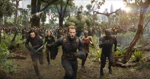 The Avengers, led by Captain America and Black Panther, run towards an unseen foe