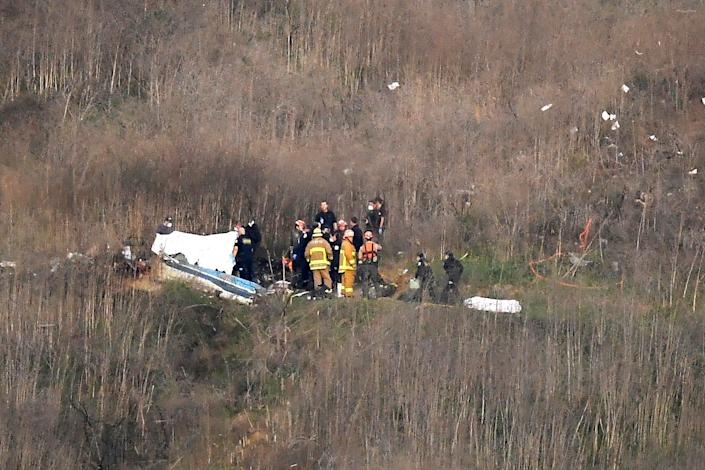 First responders are on the scene of the helicopter crash that killed Kobe Bryant and eight others in January 2020.